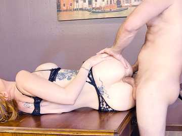 Tattooed redhead girl Lauren Phillips gets screwed sideways on the table in the office room